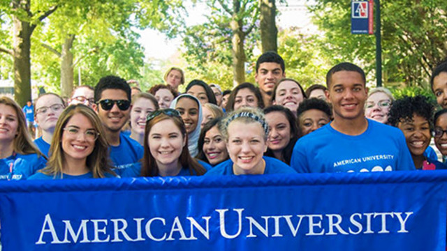 Diverse group of students holding sign of American University