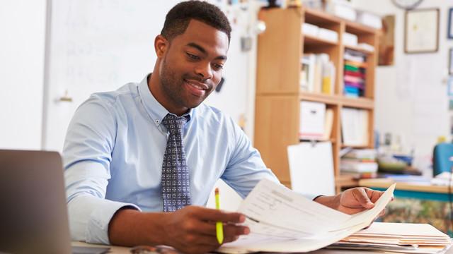 Teacher studying at desk