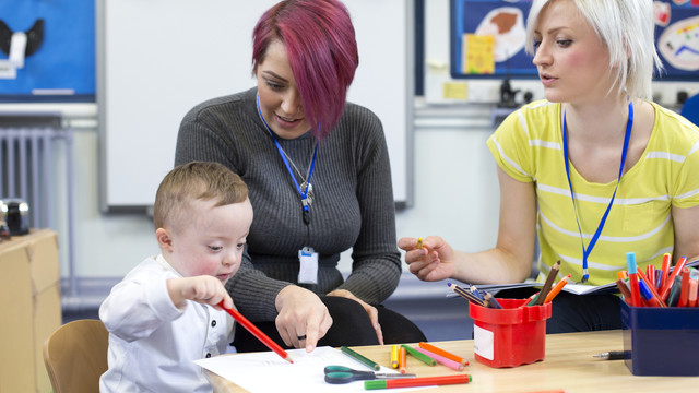 Teachers Working with Child