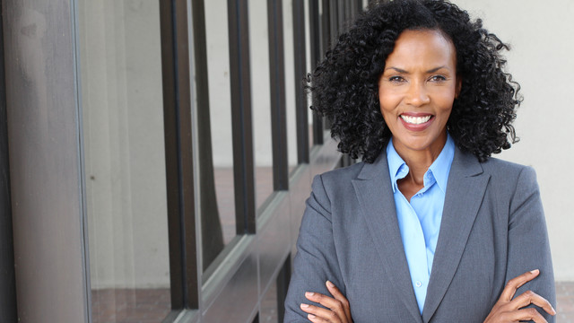 Teacher with arms crossed who is ready to get some more leadership skills under her belt